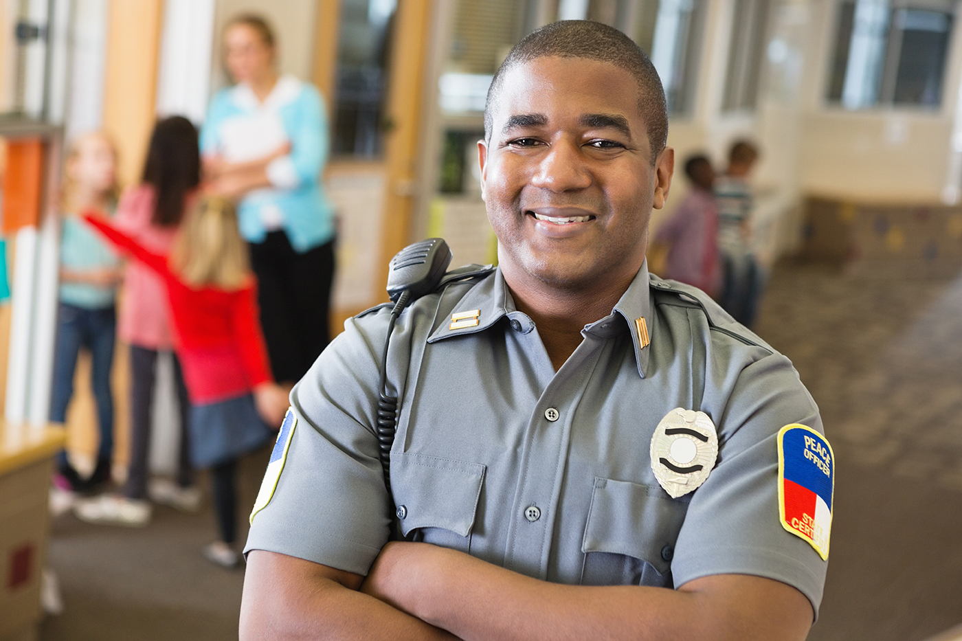 Happy police officer because he is subscribed to the PikMyKid emergency notifications